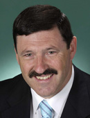 Official Australian Government portrait of Mike Kelly MP, defence materials minister and twitter libel fighter