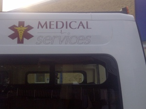"Medical Services Ltd on"" NHS "" ambulance.They passed the Care Quality Care Commission inspection for Hertfordshire,but many others didn't Pic taken by myself"