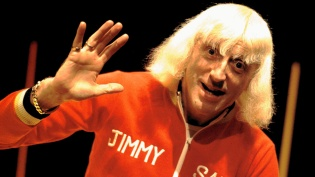 Jimmy Saville presents BBC Top Of The Pops in the early 1970s. (Photo by Michael Putland/Getty Images)